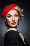 Beautiful lady in red beret Royalty Free Stock Photography