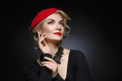 Beautiful lady in red beret Stock Photos