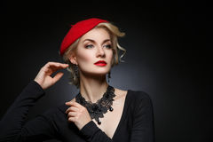 Beautiful lady in red beret Royalty Free Stock Image