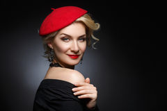 Beautiful lady in red beret Royalty Free Stock Photos