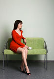 Beautiful lady in red dress Stock Images