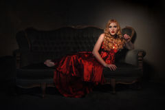 Beautiful Lady in Red Dress and Dramatic Lighting Royalty Free Stock Images