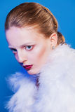 Beautiful lady with red lips and cape of feathers Royalty Free Stock Image