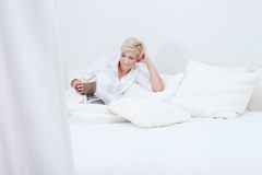 Beautiful lady relaxing in bed at the morning. Royalty Free Stock Photos