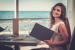 Beautiful lady in a restaurant Royalty Free Stock Photography