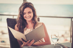 Beautiful lady in a restaurant.  stock photography