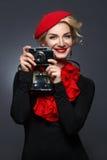Beautiful lady with retro photo camera Stock Photos