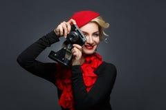Beautiful lady with retro photo camera Stock Photo