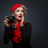 Beautiful lady with retro photo camera Stock Images