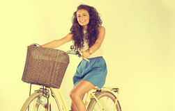 Beautiful lady riding her bike in the studio Royalty Free Stock Photos