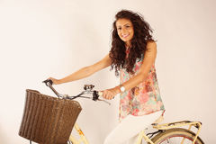 Beautiful lady riding her bike in the studio Royalty Free Stock Images