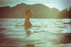 Beautiful lady in sea. Young beautiful lady in the sea at sunset Royalty Free Stock Photography