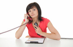 Beautiful lady secretary speaking on the phones Stock Images