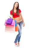 Beautiful lady with shopping bags, isolated on white background Stock Photography