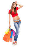 Beautiful lady with shopping bags, isolated on white background Royalty Free Stock Images
