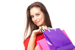 Beautiful lady with shopping bags, isolated on white background Stock Images