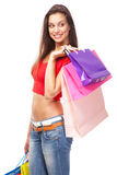 Beautiful lady with shopping bags, isolated on white background Royalty Free Stock Photography
