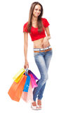 Beautiful lady with shopping bags, isolated on white background Royalty Free Stock Photos