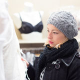 Beautiful lady shopping in lingerie store. Royalty Free Stock Photography