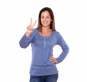 Beautiful lady showing victory sign with fingers Stock Photography