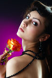 Beautiful lady with a single rose. The portrait of a beautiful lady with a single ros Stock Image
