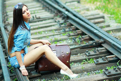 Beautiful lady sit on the rails Royalty Free Stock Photos