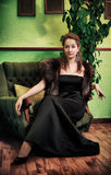 Beautiful Lady Sitting in Armchair Royalty Free Stock Image