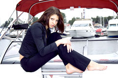 Beautiful Lady Sitting On A Ship Royalty Free Stock Photos