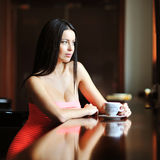 Beautiful lady sitting in the restaurant with a cup of coffee Royalty Free Stock Photos