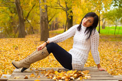 Beautiful lady sitting on the table in the park Stock Photos