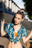 Beautiful lady with skateboard in the city royalty free stock photo