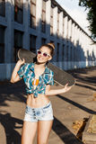 Beautiful lady with skateboard in the city Royalty Free Stock Images
