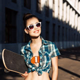 Beautiful lady with skateboard in the city Stock Photo