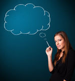 Beautiful lady smoking cigarette with idea cloud Royalty Free Stock Images