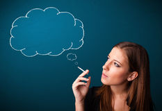 Beautiful lady smoking cigarette with idea cloud Stock Photography