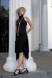 Beautiful lady standing at column Royalty Free Stock Photos