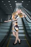 Beautiful lady standing on the escalator Stock Image