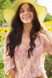 Beautiful lady in sunflower field Stock Image