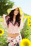 Beautiful lady in sunflower field Stock Images
