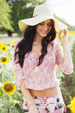 Beautiful lady in sunflower field Royalty Free Stock Images