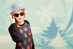 Beautiful lady in sunglasses and hat on digital Stock Image