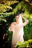 Beautiful lady in sunlight garden royalty free stock image