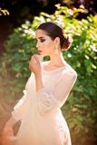 Beautiful lady in sunlight garden royalty free stock photo