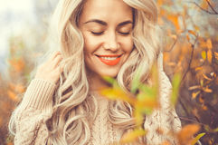 Beautiful lady surrounded autumn leaves Royalty Free Stock Photo