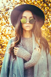 Beautiful lady surrounded autumn leaves Royalty Free Stock Photos