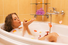 Beautiful lady taking a bath Stock Photos