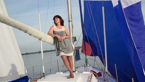 Beautiful lady thinking about life. Yachting, traveling, tourism. Stock footage stock video footage