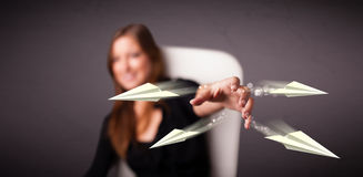 Beautiful lady throwing origami airplanes Stock Photos