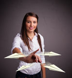Beautiful lady throwing origami airplanes royalty free stock photo