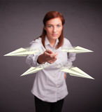 Beautiful lady throwing origami airplanes Stock Image